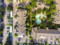 Typical green apartment living and swimming pool in Texas, USA. Aerial view of typical multi-level apartment building complex with swimming pool, surrounded by stock photo