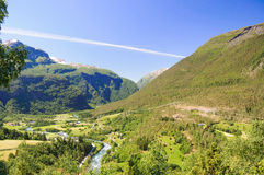 Typical green meadows and mountain landscape in Norway Royalty Free Stock Photo
