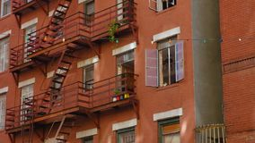 Typical Gritty Apartments Above Restaurants in Little Italy. A daytime establishing shot of apartments located above a restaurant in Manhattan`s Little Italy stock footage