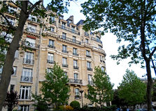 Typical Haussmann french building Stock Photos