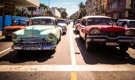 Typical Havana street scene. Street crowded with old colorful cars in Vedado, Havana Stock Photo