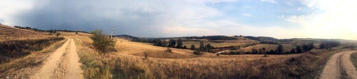 Hills in Oltenia panorama. Typical hills landscape in the historic region of Oltenia, Romania, near the village of Cremenea, Mehedinti County Stock Image