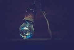 Typical hipsters theme vintage and modern contemporary in the same time background. Old Fashioned Electric Lamp Photo stock photos