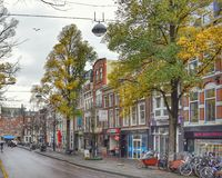 Typical Holland street. Building tourism color autumn fall day home bike road city town center on 11.21.2016 Stock Image