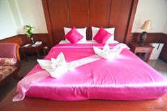 Typical hotel room with queen size bad. With Thai style royalty free stock photography