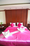Typical hotel room with queen size pink bad with Thai style Stock Photo