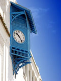 Typical house with deep blue shutters clock in Sidi Bou Said,Tunisia. Vertical photo of typical tunisian house with deep blue  shutters with clock and blue sky Stock Photos