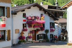 Typical house with flowers in Rocca Pietore, Veneto, Italy. stock photo