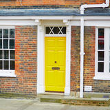 Typical house in London with yellow door Royalty Free Stock Photos