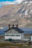 Typical house with metal chimneys in Longyearbyen, Svaldbard, Spitzbergen. In spring Royalty Free Stock Photo
