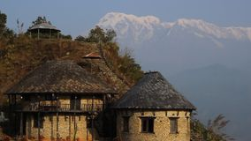 A typical house in the mountains. In the background you can see Annapurna stock video