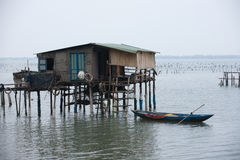 Typical House on the sea Lang Co, Hue, Vietnam. Typical House on the sea Lang Co, Hue Vietnam, with a small houseboat. Vietnam Royalty Free Stock Photography