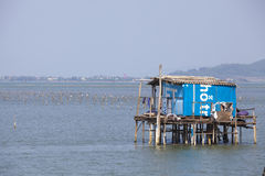 Typical House on the sea Lang Co, Hue, Vietnam. Typical House on the sea Lang Co, Hue Vietnam, with a small houseboat. Vietnam Stock Images