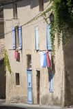 Typical house in south France with blue shutters and drying laun Royalty Free Stock Photo