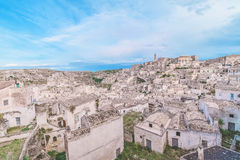 Typical house of stones (Sassi di Matera)  and church of Matera under blue sky. Matera in Italy Stock Images