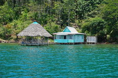 Typical house with thatched hut over water Panama Royalty Free Stock Photography