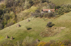 Typical household on a village hill. Typical household on a hill, in the idylic village of Holbav, Brasov County, Romania Stock Image