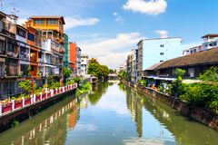 Typical houses with a canal in the center of Bangkok, Thailand Stock Images