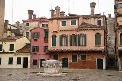 Campo della Maddalena, Venice, Italy. Typical houses of the minor building, of very varied dimensions and colors, embellished by the barbacans and the multiple royalty free stock photos