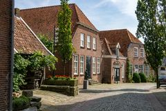 Typical houses in Ootmarsum at the `Ganzenmarkt`. royalty free stock photos