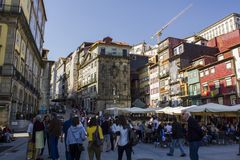 Typical houses and outdoor cafes at historic Ribeira Square of Porto royalty free stock image