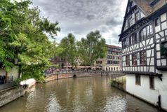Typical houses in Strasbourg. Typical houses near the canal of Petite-France area in Strasbourg, France. Photo in HDR Royalty Free Stock Photos