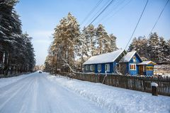Typical houses in the urban-type settlement in Leningrad oblast at winter. Russia Stock Photos