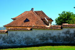 Typical houses in the village Merghindeal- Mergenthal, Transylvania,Romania Stock Photos