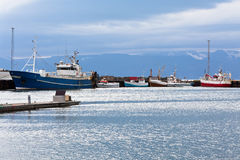 Typical Iceland Harbor with Fishing Boats at Overcast Day Royalty Free Stock Photos