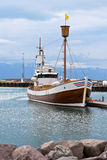 Typical Iceland Harbor with Wooden Ship at Overcast Day Royalty Free Stock Image