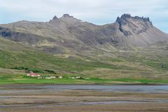 Typical Iceland landscape with farms stock photo