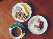 Typical Icelandic breakfast: cheese, flatbread, eggs, berries, coffee Royalty Free Stock Images