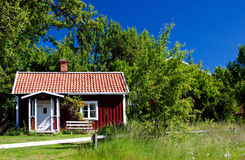 Typical idyllic cottage in Sweden . Stock Photos