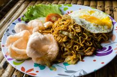 Typical Indonesian dish mie goreng close up full plate.  stock photo