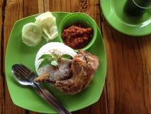 Typical Indonesian dish: Nasi ayam lalapan.  royalty free stock photo