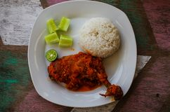Typical Indonesian Dish: Nasi Ayam Plecing Chicken with rice and special sauce bird`s-eye.  stock image