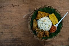Typical Indonesian dish Nasi liwet from top with copy space on the left.  royalty free stock images