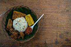 Typical Indonesian dish Nasi liwet from top with copy space on t. He right stock photo