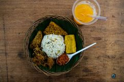 Typical Indonesian dish Nasi liwet from top with juice.  stock photos