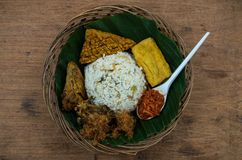 Typical Indonesian dish Nasi liwet from top view centered.  Royalty Free Stock Photos