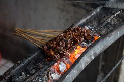 Typical Indonesian dish Sate ayam on local street market - diagonal.  royalty free stock image