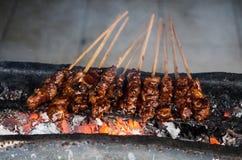 Typical Indonesian dish Sate ayam on local street market - horizontal.  stock photos