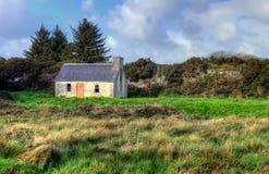 Typical Irish abandoned house. Typical Irish abandoned house on meadow Stock Photos