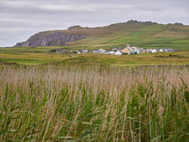 Typical Irish houses. Cover the hilly landscape of Dingle, Ireland Royalty Free Stock Photos