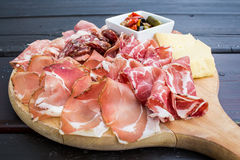 Typical Italian appetizer with salami, cheese and pickles Royalty Free Stock Photos