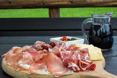 Typical Italian appetizer with salami, cheese and pickles Stock Photos
