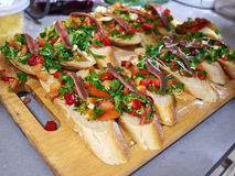 Typical Italian Bruschetta with tomatoes, herbs and oil on toast Royalty Free Stock Photo