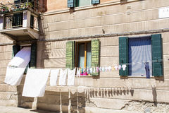 Typical italian building with hanging laundry Royalty Free Stock Photos
