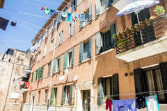 Typical italian building with hanging laundry Royalty Free Stock Photo