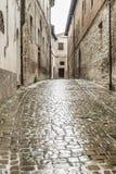 Typical italian city street at rain Stock Photos